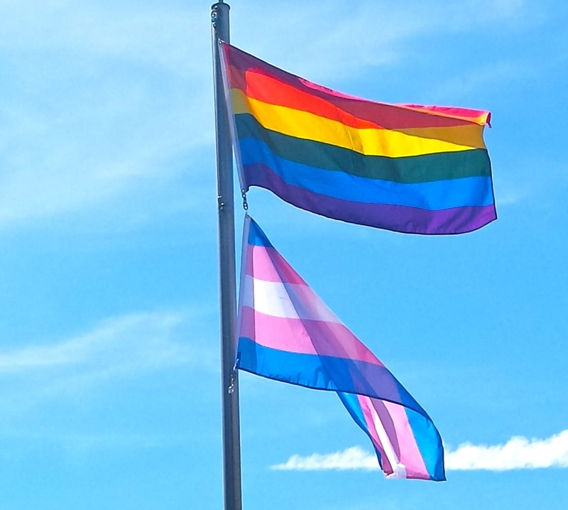 Rainbow & Trans Flags flying.