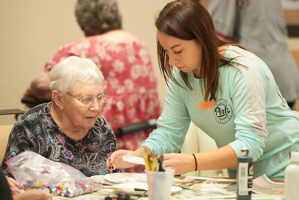 Student facilitating therapeutic recreation activity with older adult.