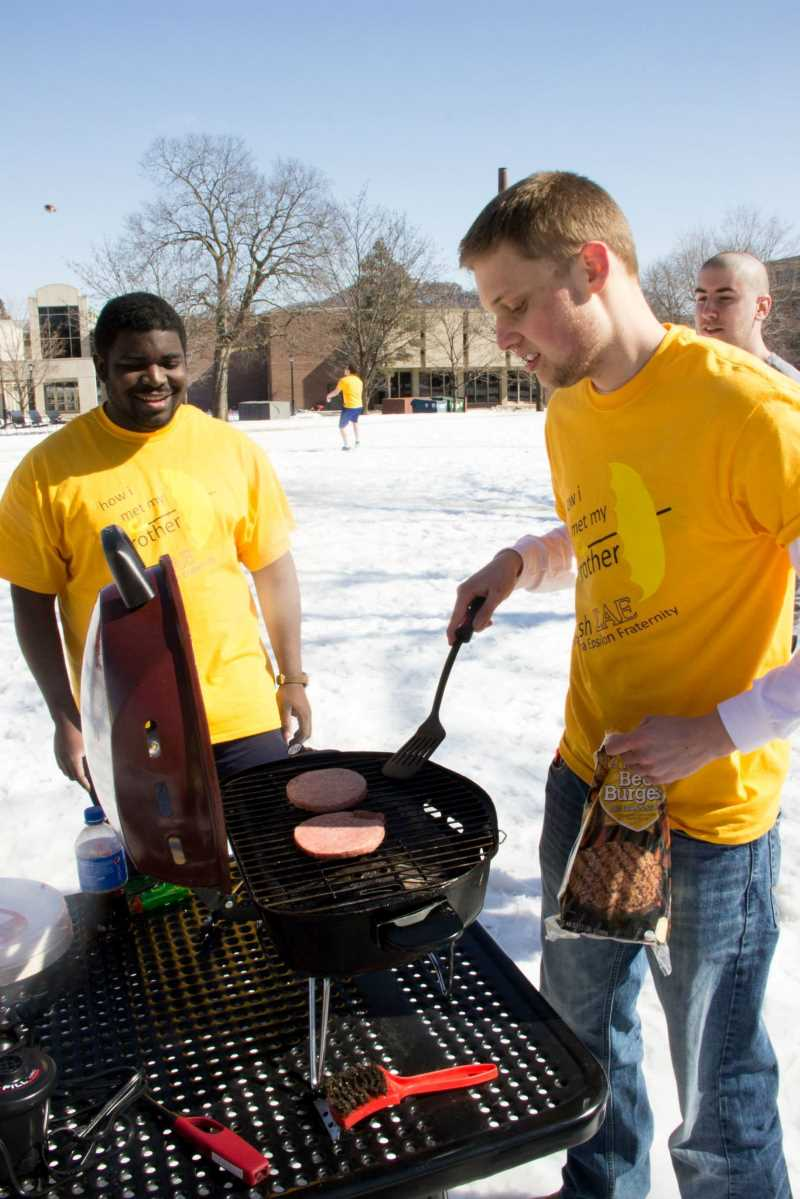 "Lamda Chi members grill outside in the snow for their ""How I Met Your Mother"" brotherhood."