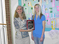 Crystal Stundahl receiving the CLS student of the year award from Diane Sewell