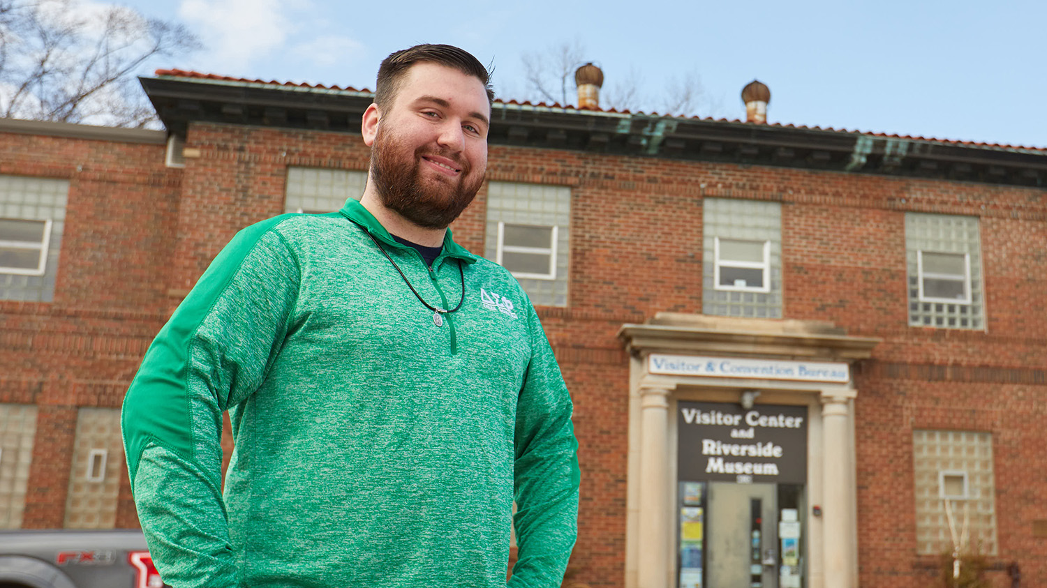 Tourism Emphasis student, Ross Ramsey, outside the La Crosse County Convention & Visitors bureau.