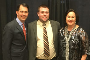 ourism Emphasis student Mark Davis, center, with Wisconsin Gov. Scott Walker, left, and Stephanie Klett, secretary of the Wisconsin Department of Tourism at the Wisconsin Governor's Conference on Tourism (WIGCOT)